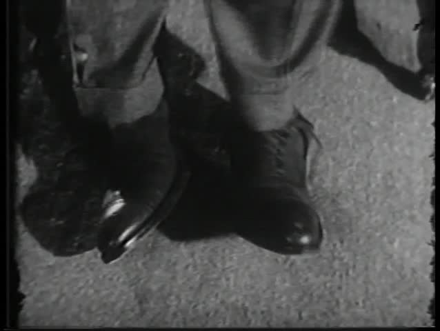 Close-up of feet moving in tight shoes