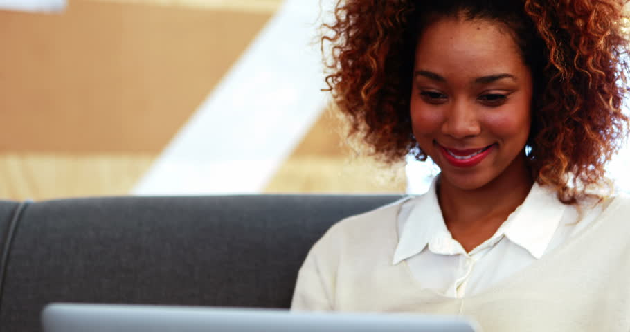 Businesswoman with curly hair smiling in office 4k | Shutterstock HD Video #18523769