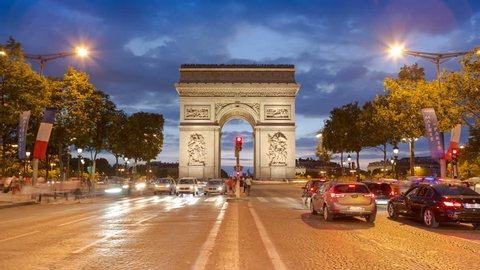 Arc de Triomphe - Paris traffic on Champs-Elysees at night 4k