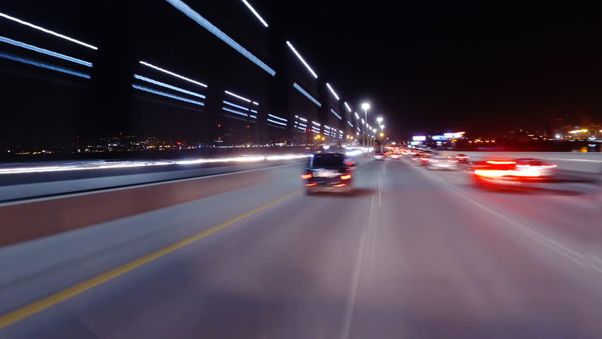 Hyperlapsed view from a car at night. POV. Oakland Bridge and freeways in San Francisco, United States. Perfect to represent concepts as autonomous driving, futuristic cityscape, city life, etc.