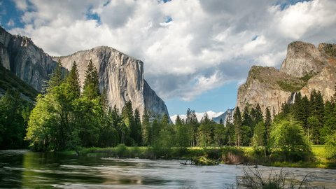 Merced River In Yosemite National Park. El Capitan and Half Dome are in the background.