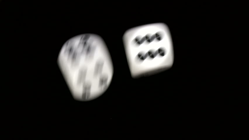 Rolling dice in slow motion with numbers six and six