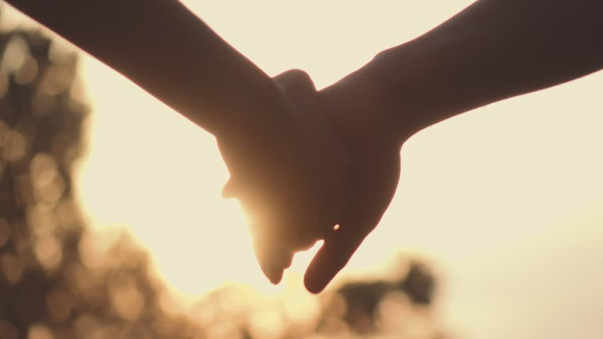 Close up of two Lovers Joining Hands. SLOW MOTION 240 fps. Detail Silhouette of Man and Woman holding hands over the Sunset Lake Background. Couple Trust, Love and Happiness concept. | Shutterstock HD Video #18598205