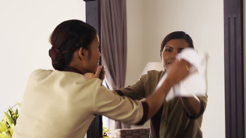 Portrait of happy Asian housekeeper at work in luxury resort room as maid and smiling at camera, housemaid working in hotel