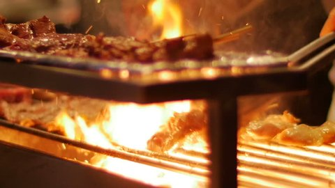 Barbecue on the grill, Grilling pork chops, meat slices roasting on bbq grid plate with camera moving