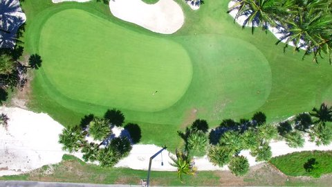 Aerial - Beautiful view of Golf Course next to ocean looking down.