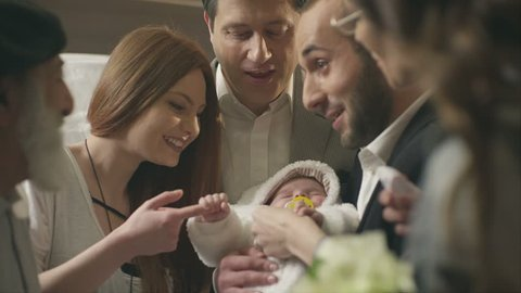 Happy family playing with little child with happy emotions and celebrating his birthday.  Shot on RED EPIC Cinema Camera in slow motion.