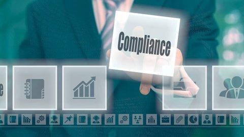 Businessman pressing an Compliance concept button on a blue background