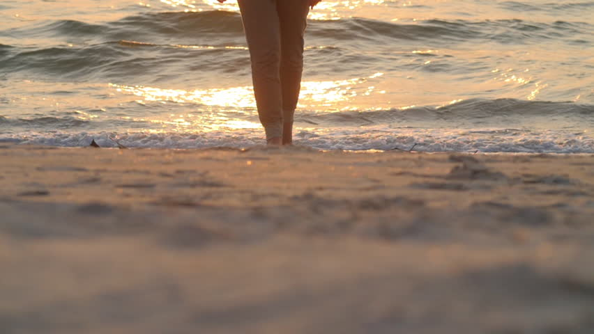 Girl walking on sand beach sunset | Shutterstock HD Video #18904439