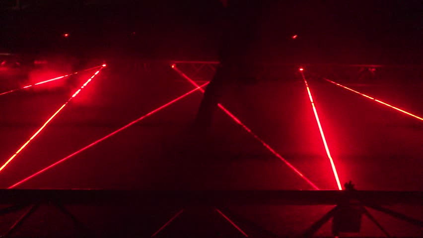 red laser beams used in security demonstration at night. Panorama. 4K #18904859