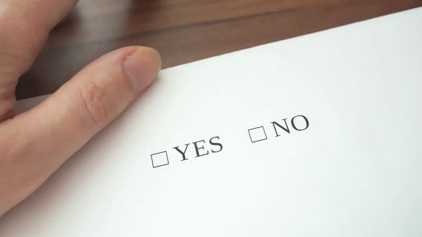 Hand is filling form with yes and no checkboxes, making decision and rejecting it by writing check symbol on no checkbox. | Shutterstock HD Video #18908729