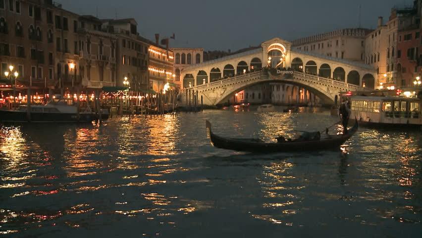 Gondola in front of Rialto Bridge on the Canale Grande in Venice, Italy