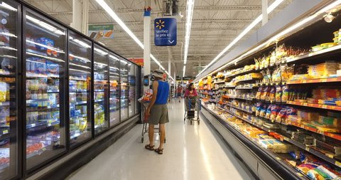 MONTREAL, CANADA - AUGUST 2016: Shopping Inside Walmart - Professional Steadicam Shot (Refrigerated Dairy Products, Eggs, Cheese, Butter, Yogurt & Ice Cream)