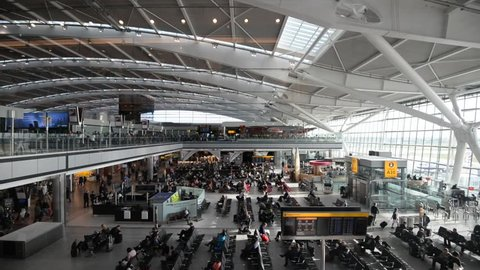 LONDON - MAY 21, 2015: People walking inside terminal of Heathrow Airport, the busiest airport in the United Kingdom and the busiest airport in Europe by passenger traffic.
