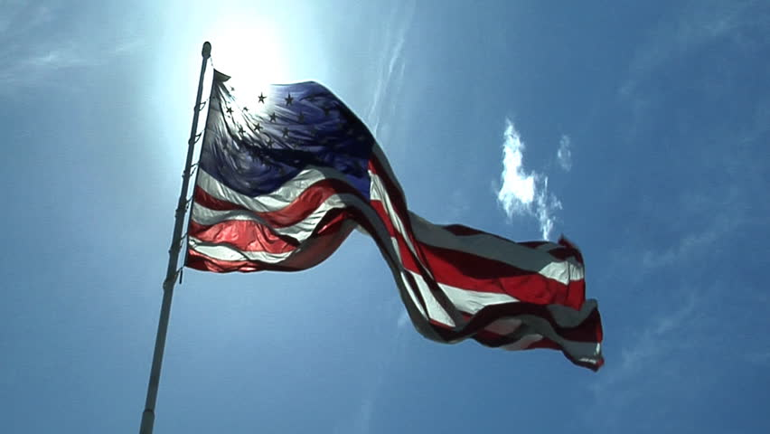 HD clip of the American flag against a beautiful blue sky.