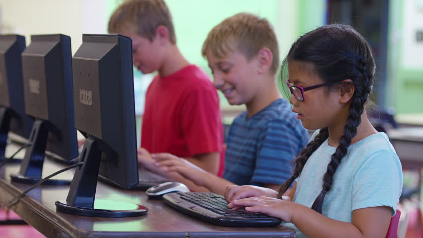 Row of students work on computers at school   Shutterstock HD Video #19004659