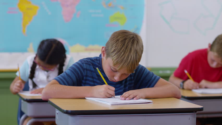 Teacher helping student with writing project in school classroom | Shutterstock HD Video #19004710