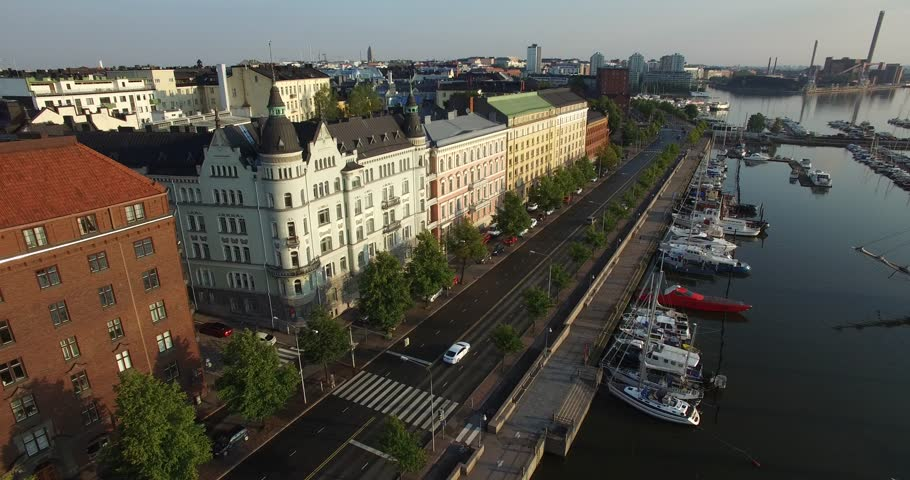 Aerial view of Helsinki bay area and drone video of old city skyline, boats and yachts in Helsinki harbour, the capital of Finland