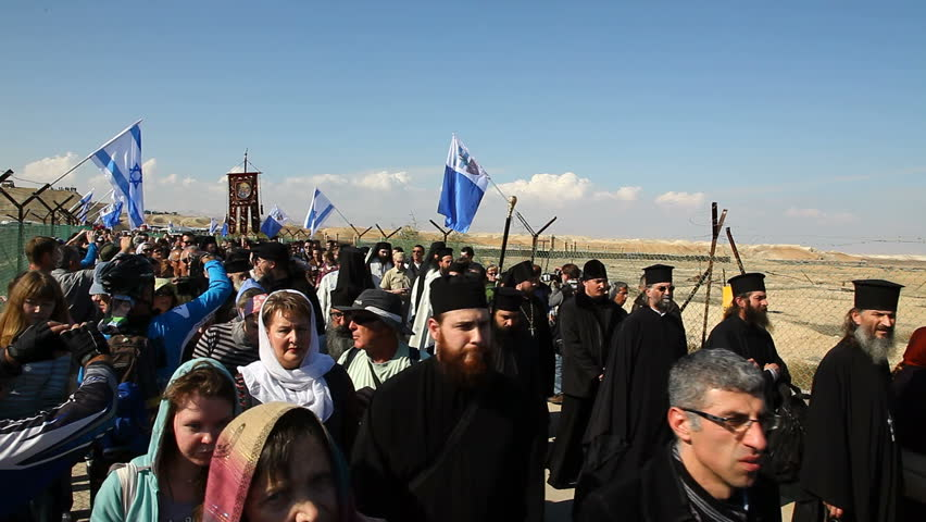 QASR AL YAHUD, ISRAEL - JANUARY 18: Greek Orthodox Patriarch's procession with priests and pilgrims at march in Qasr Al Yahud Baptismal Site, Israel on January 18, 2012.
