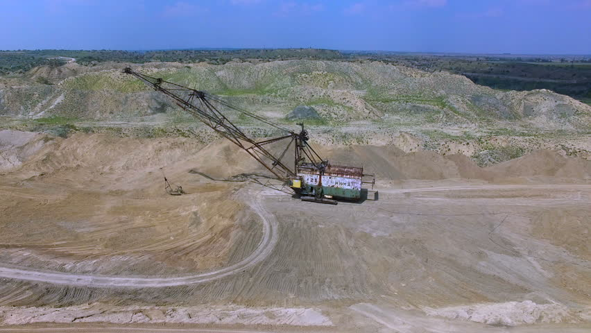Flying over the excavator in a quarry. Production of manganese ore. aerial survey | Shutterstock HD Video #19027939