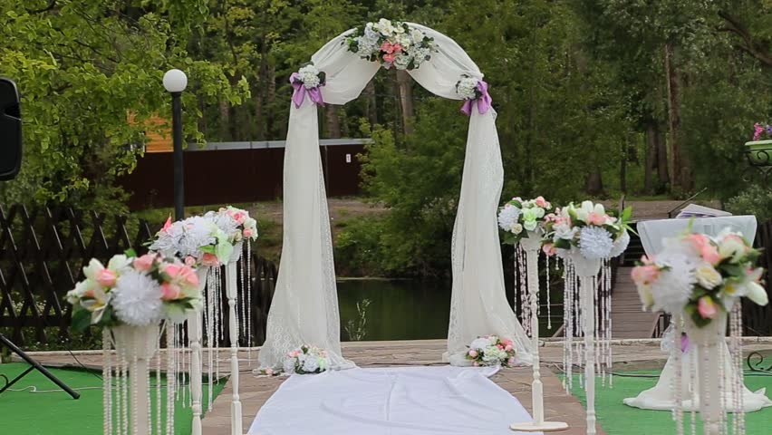 Wedding arch decorated with flowers before the wedding ceremony in wedding decorations wedding arch hd stock video clip junglespirit Choice Image