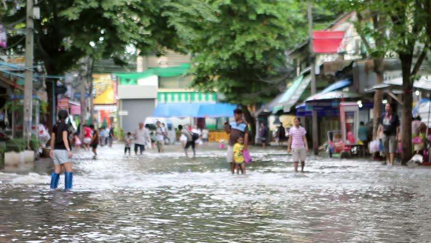Street under flood in Bangkok Thailand. Life continues