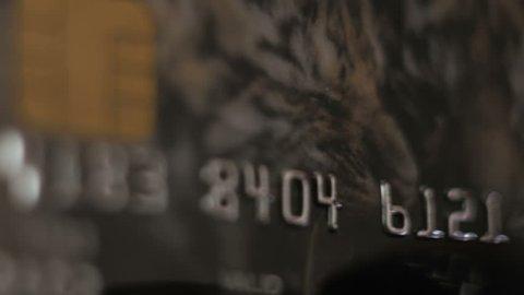 Credit Card swipe through PIN Terminal. Extreme closeup. Shallow depth of field
