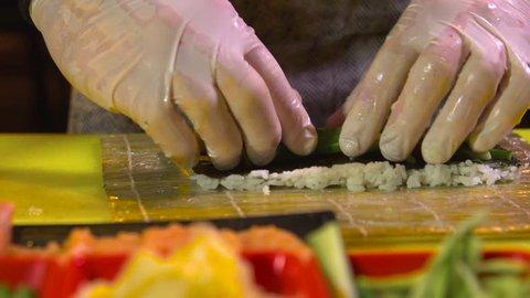 Chef prepares vegetarian sushi roll
