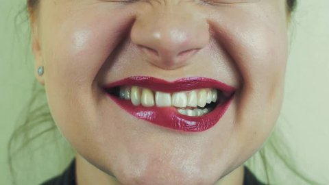 Woman with red pomade emphatically sing song in front camera. Pronounce words. Close up