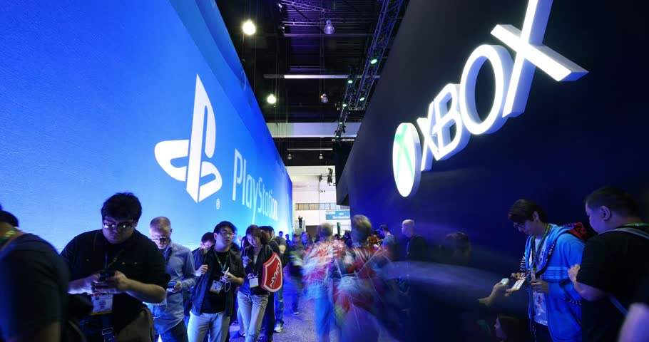 LOS ANGELES - June 16, 2016: Gamers wait in line to enter Sony Playstation and Microsoft Xbox booths during E3 2016 gaming conference at the Los Angeles Convention Center. 4K UHD Timelapse.