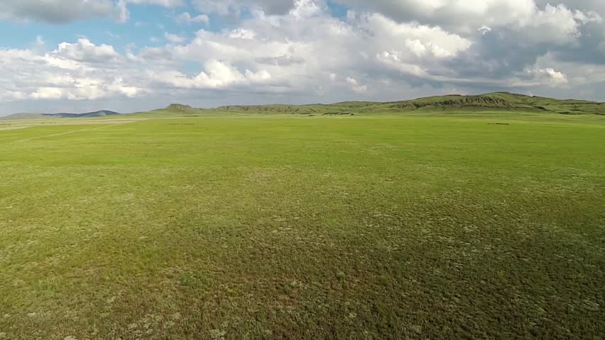 grass field aerial. Aerial View Of In The Steppe Kazakhstan. Aerophotography - HD Stock Footage Clip Grass Field