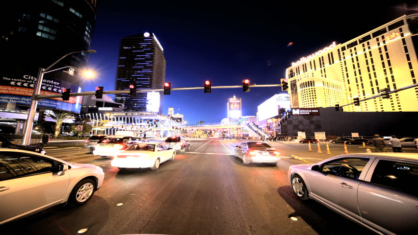 Timelapse point of view driving through the streets of Las Vegas as the sun goes down