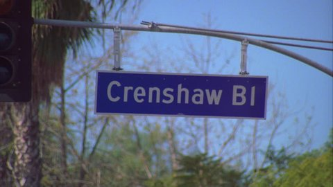 day Close street sign Crenshaw Bl. palm trees background Los Angeles