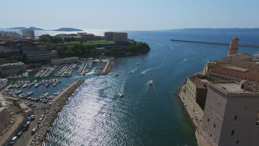 MARSEILLE, FRANCE - JUL 30, 2016: City panorama with fort Saint-Jean and vessels sail by Avant port Joliette near Old port and Parc du Pharo at summer sunny day. Aerial view