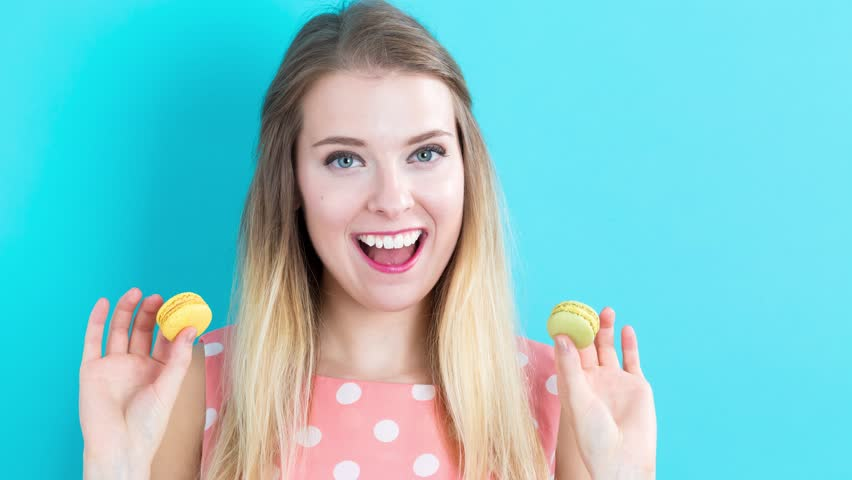 Time-lapse of a young woman doing a variety of poses with food on on vibrant blue background | Shutterstock HD Video #19240219