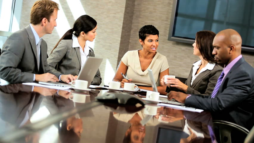 Female african american executive in a boardroom meeting with her multi ethnic business team | Shutterstock HD Video #1924909