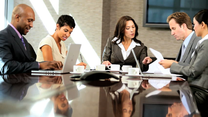 Female caucasian business executive in meeting with her multi ethnic team #1924933