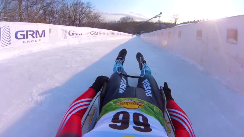 MOSCOW, RUSSIA - JANUARY 23, 2016: Tobogganer slides down the track during Luge World cup at Sparrow Hills (Vorobyovy Gory). View from the first person.