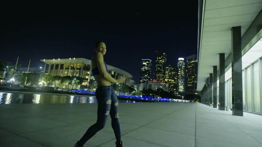 Professional dancer dances on the roof top of downtown LA. Great night background/view. | Shutterstock HD Video #19285369