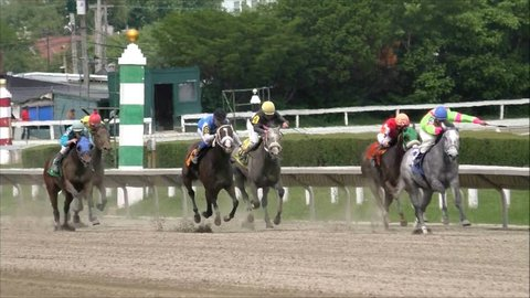 Suffolk Downs Boston, USA - June 10, 2014 - Winning jockey gets his horse across the track's finish line first.