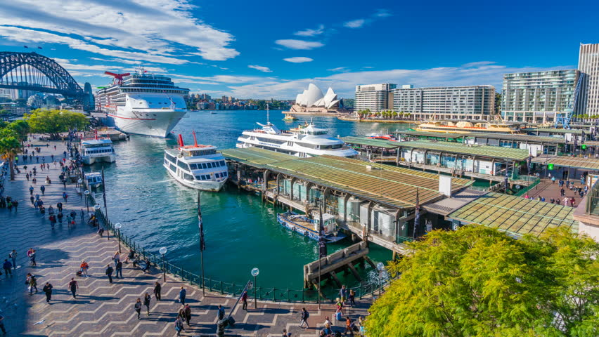 Sydney, Australia - June 23, 2016: 4k hyperlapse video of ferries and people visiting Circular Quay in Sydney CBD, with view of Harbour Bridge and Opera House