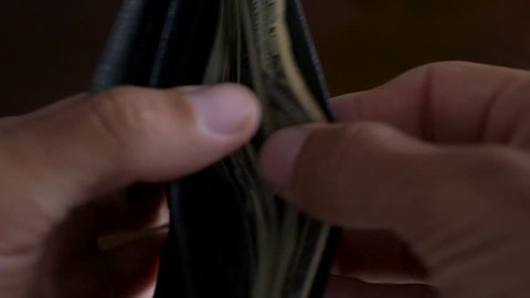 Close-up of a businessman hands counting hundred dollar bills in wallet. Close Up Male Hands Count Hundred Dollar Bills.