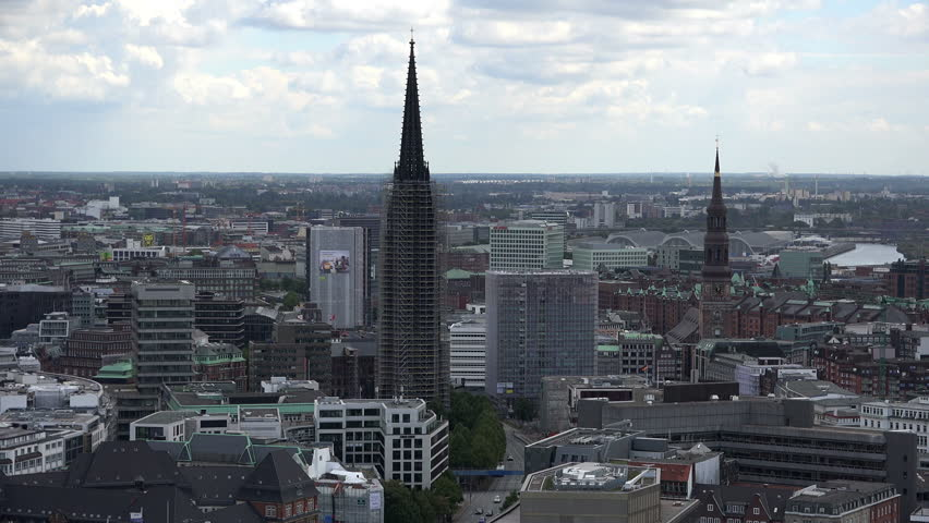 HAMBURG, GERMANY - AUGUST 23, 2014: Aerial view of Hamburg with the town hall and two churches. St. Petri is Hamburgs oldest church.    Shutterstock HD Video #19367269