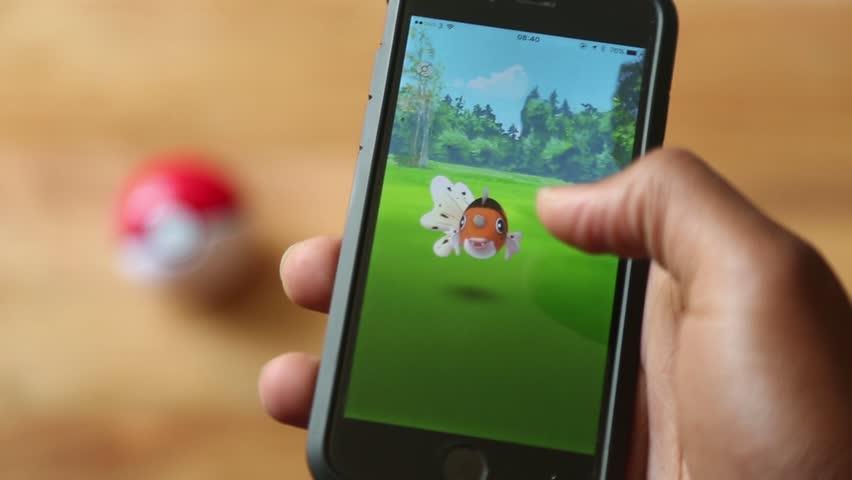 Man Plays Pokemon Go  | Shutterstock HD Video #19388071