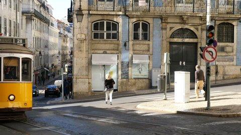 Lisbon street - November 29: vintage Lisbon tram on city street, sunny day, November 29, 2015, Lisbon, Portugal
