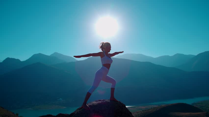 4K yoga in the mountains,the sunrise, beautiful girl in white clothes doing yoga, slow motion