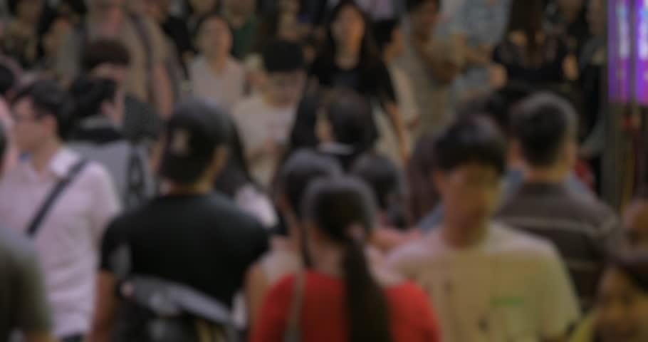Defocused shot of people traffic on Hong Kong street. Crowd in the metropolis, faces unidentified | Shutterstock HD Video #19477138