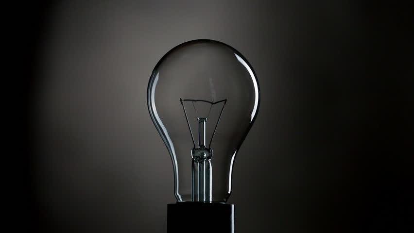 Stock video of light bulb over black background | 1952809 ...