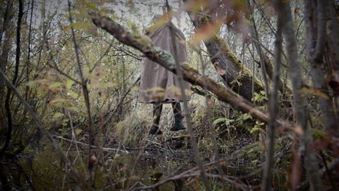 hanged man in the gloomy wood, horizontal camera movement