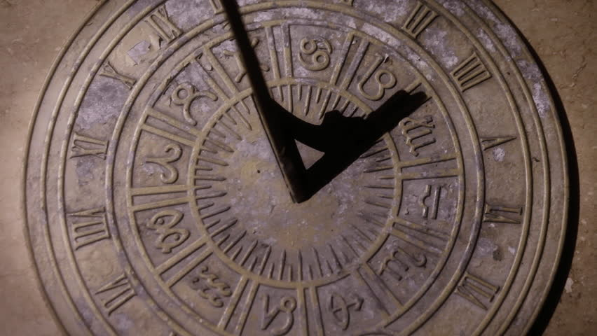 Sundial timelapse, time passing over old clock face